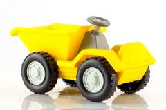 Een plastic stuk speelgoed uiteindevrachtwagen Stock Afbeeldingen