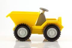 Een plastic stuk speelgoed uiteindevrachtwagen Royalty-vrije Stock Foto