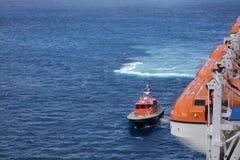 Een proefreddingsboot en reddingsboten Stock Foto's