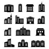 Een reeks gebouwen en huizenpictogrammen Stock Foto's