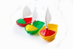 Een reeks stuk speelgoed boten Stock Fotografie