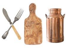 Een reeks van antiquiteiten, vork, mes, raad en melk kan stock afbeeldingen
