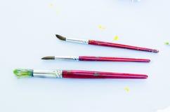Een reeks van drie vuile penselen Royalty-vrije Stock Fotografie