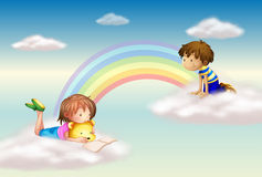 Een regenboog met jonge geitjes Royalty-vrije Stock Fotografie