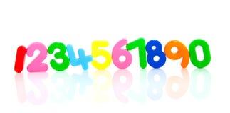 Een rij van kleurrijke plastic aantallen Stock Fotografie