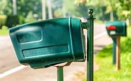Een rij van postdozen in een landelijke gemeenschap Stock Fotografie