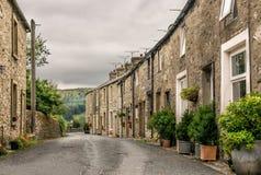 Een rij van terrasvormige huizen of plattelandshuisjes royalty-vrije stock afbeeldingen