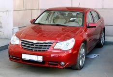 Een rode auto Stock Foto's