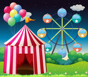 Een rode circustent met ballons Stock Foto