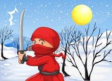 Een rode ninja in de sneeuw Stock Foto
