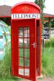 Een rode telefoon Stock Afbeeldingen