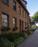 Een rood en oud baksteengebouw binnen de stad in van Charlottetown, Prins Edward Island royalty-vrije stock afbeeldingen