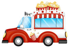 Een rood voertuig die popcorns verkopen Stock Foto