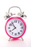 Een roze wekker op een witte achtergrond Royalty-vrije Stock Foto