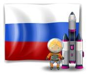 Een Russische vlag met een ontdekkingsreiziger naast een raket Stock Fotografie