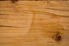 Een ruwe houten oppervlakte met natuurlijke patronen, en knopen royalty-vrije stock afbeeldingen