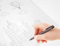 Een schets van de persoonstekening van een stad met ballons en wolken op a stock afbeeldingen
