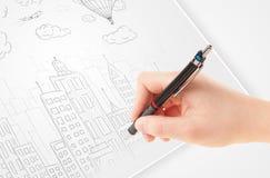 Een schets van de persoonstekening van een stad met ballons en wolken op a royalty-vrije stock afbeeldingen