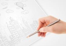 Een schets van de persoonstekening van een stad met ballons en wolken op a stock afbeelding
