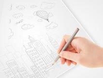 Een schets van de persoonstekening van een stad met ballons en wolken op a stock foto's