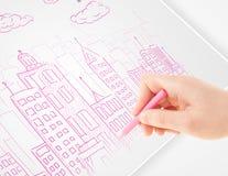 Een schets van de persoonstekening van een stad met ballons en wolken op a stock foto