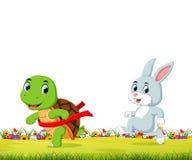 Een schildpad wint de race tegen een konijn royalty-vrije illustratie