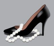 Een schoen en parelparels Stock Afbeelding