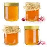 Een selectie van kruiken honing stock fotografie