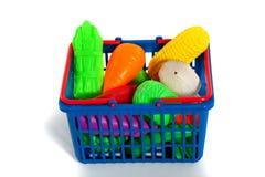 Een shoppingcarthoogtepunt van groenten Royalty-vrije Stock Fotografie