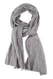 Een sjaal is grijs op een knoop op een witte achtergrond wordt vastgebonden die Stock Foto's