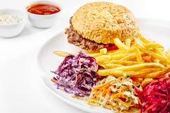 Een smakelijk voedsel. Grote hamburger, Frieten. Hoog - kwaliteitsbeeld Stock Fotografie