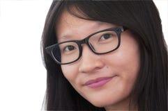Een smirking Chinese vrouw Stock Foto