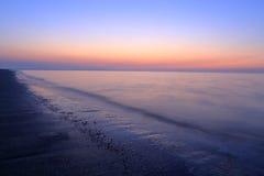 Een spectaculaire zonsopgang over het overzees Royalty-vrije Stock Afbeeldingen