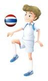 Een speler die de bal met de vlag van Thailand gebruiken Royalty-vrije Stock Afbeeldingen