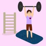 Een sportieve mens in een gymnastiek Royalty-vrije Stock Afbeelding