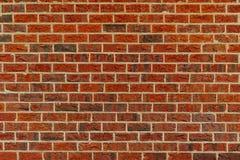 Een standaard rode bakstenen muur stock foto