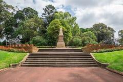 Een standbeeld van Koningin Victoria in Koningenpark en Botanische Tuinen i Stock Fotografie