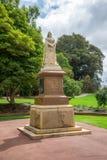 Een standbeeld van Koningin Victoria in Koningenpark en Botanische Tuinen i Royalty-vrije Stock Fotografie