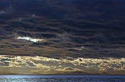 Een stormachtige zonsondergang dichter Stock Afbeelding