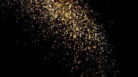 Een straal van licht met deeltjes van gouden poeder stock videobeelden