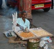 Een straatventer stock foto