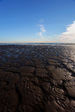 Een strand at low tide. Royalty-vrije Stock Fotografie