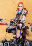 Een studio schoot van ` Aloy ` de Heldin van Horizon Nul Dawn ` van het Guerillaspel ` exclusief voor Sony Playstation Stock Foto's