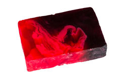 Een stuk van rode zeep op wit stock afbeeldingen