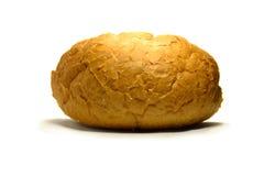 Een stuk van vers brood op een witte achtergrond isoleer Royalty-vrije Stock Foto's