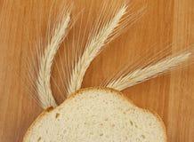 Een stuk van wit brood Stock Afbeelding