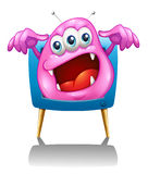 Een televisie met een roze monster Stock Afbeeldingen