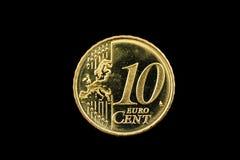 Een tien eurocentmuntstuk op zwarte Royalty-vrije Stock Fotografie
