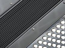 Een toetsenborddeel van zwarte harmonika in close-up stock afbeeldingen