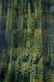 Een van de het schuimtextuur van het mengelings donkerblauw, geel en groen polyethyleen close-up als achtergrond macroschuimplast Stock Fotografie